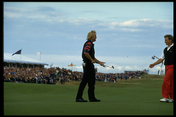 A victorious Greg Norman walks to shake hands with Bernhard Langer at Royal St. Georges in the 1993 British Open.