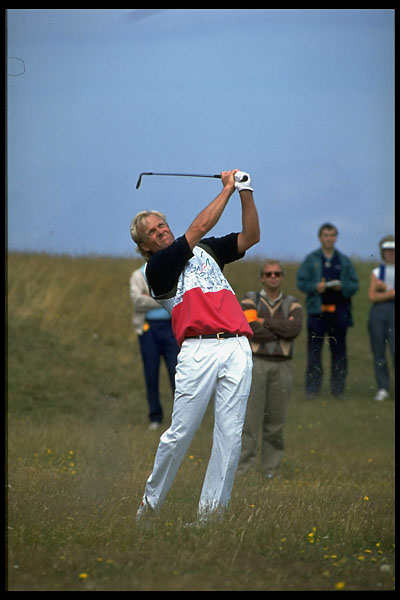 Greg Norman hits from rough at the 1991 British Open at Royal Birkdale.