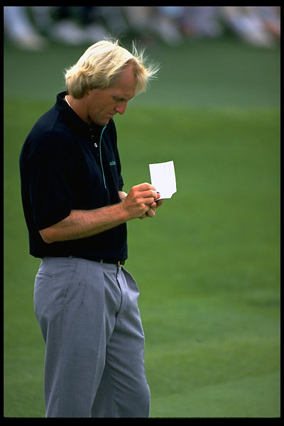 Greg Norman writes in his scorecard at the 1991 Masters.