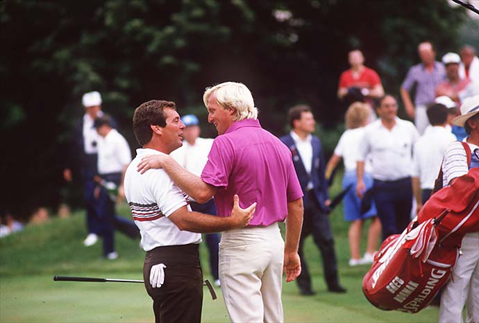 Greg Norman congratulates Fuzzy Zoeller after their Zoeller won their playoff round at the 1984 US Open at Winged Foot in Mamaronek, N.Y.