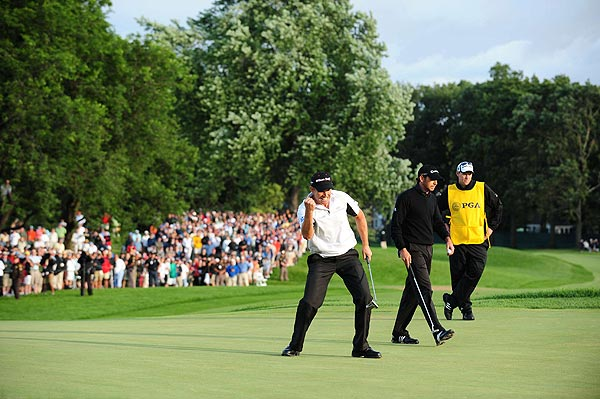 SI's Best Shots from the PGA                       SI's Fred Vuich captured these images over the four days at Oakland Hills.                                              Padraig Harrington sunk a par putt on 18 to secure his second-straight major championship at the PGA on Sunday.