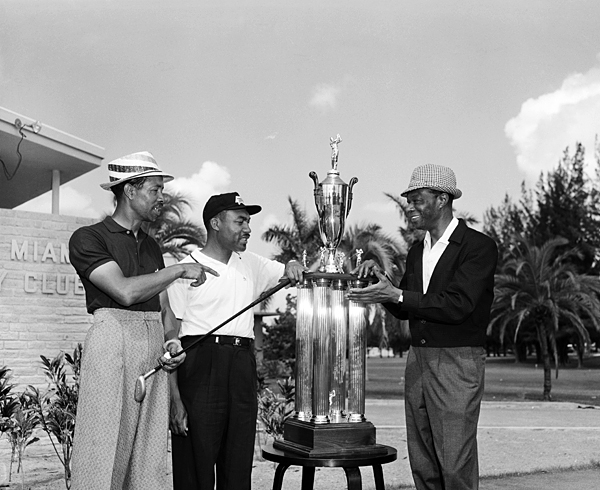 "Sifford, center, with the golfer Teddy Rhodes, left, and the singer Nat ""King"" Cole at the 1958 North-South Negro Golf Tournament at the Miami Country Club. Sifford won the National Negro Championship five straight times in the '50s, as well as the 1957 Long Beach Open, a PGA co-sponsored event."