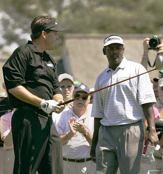 Vijay vs. Phil                       After a round at the 2005 Masters, Singh confronted Phil Mickelson in the locker room and argued that Phil's metal spikes had roughed up the greens. They reportedly had to be separated by onlookers. Ironically, the two were paired together in the final round (pictured).