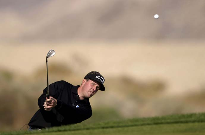 Phil Mickelson chips to the 14th green during the Skins Game on Dec. 1, 2002, at the Landmark Golf Club in Indio, Calif.
