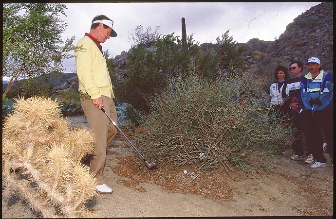 Tom Watson prepares to play a shot from the rough at the 1994 Skins Game