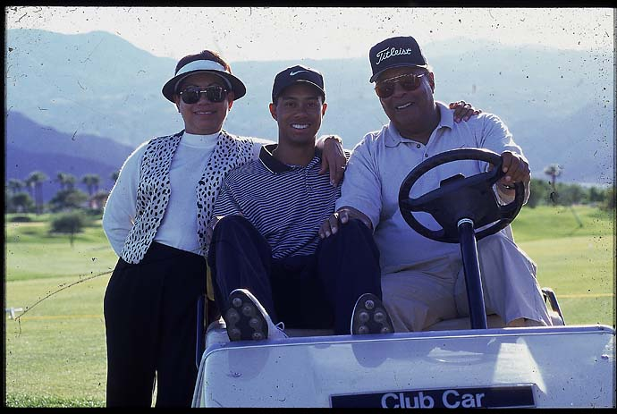 Tiger Woods with his mother, Kultida Woods, and father, Earl Woods, at the 1996 Skins Game, his debut in the game.