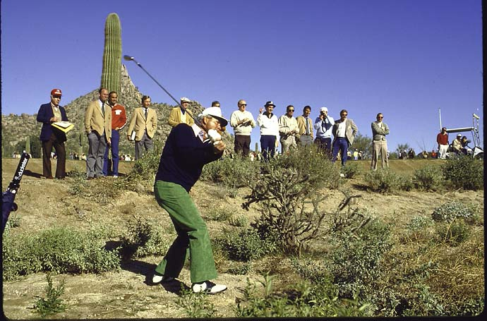 "Arnold Palmer plays out of the desert rough at the 1983 Skins Game in action alone, driving during tournament. ""I was thinking about sending somebody off for a bottle of Scotch,"" Arnold said later. ""I'd come from Bay Hill [in Orlando], and the guys I play with down there had hit me for $400 in my normal game. I'm sure they were watching TV, rooting for me to get home soon so they could rob me again."""