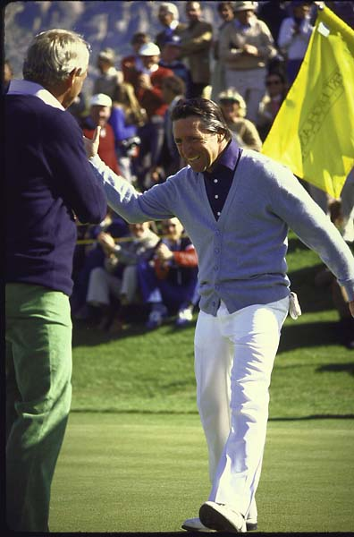 Gary Player high-fives Arnold Palmer after winning the inaugural Skins Game in 1983.