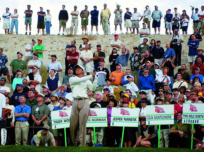 Tiger Woods tees off on the eighth hole during the first round of the Skins Game, Nov. 24, 2001, in Indio, Calif.
