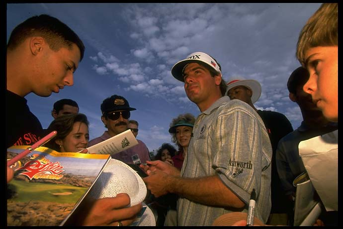 Fred Couples signs autographs for fans at the 1995 Skins Game at Bighorn in Palm Springs, Calif. It was Couples' first Skins Game win.