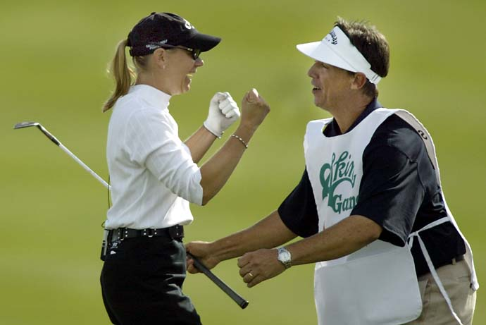 "Annika Sorenstam celebrates with her caddie Terry McNamara after sinking a bunker shot for an eagle at the ninth hole, to win $175,000 against Fred Couples, Mark O'Meara and Phil Mickelson, during the first round of the $1 million ""Skins Game"" at the Trilogy Golf Club in La Quinta, California, Nov. 29, 2003. Sorenstam was held without a skin until making the shot at the day's final hole. Mickelson won $100,000 and Couples $25,000."