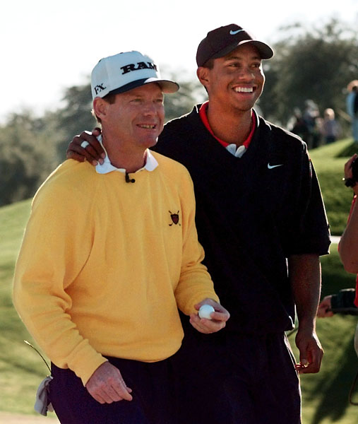 Tom Watson and Tiger Woods walk off the 10th green together after they both birdied the hole during the final round of the Skins Game, Sunday, Dec. 1, 1996, in La Quinta, Calif. Watson had seven skins worth a total of $220,000, Fred Couples had nine skins worth a total of $280,000, Woods had two skins worth a total of $40,000 while John Daly had none for the two-day tournament.