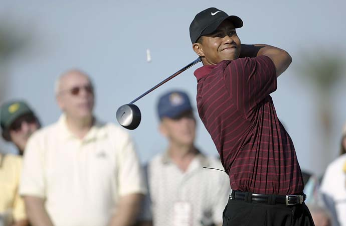 Tiger Woods tees off on the 10th hole during the Skins Game on December 1, 2002 at the Landmark Golf Club in Indio, Calif.
