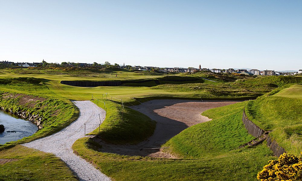 "Prestwick Golf Club 3rd (par 5, 482 yards)                     LOCAL KNOWLEDGE: ""The ideal line is to lay up short of the big bunkers as far right as you can go, reducing the angle of the dogleg and shortening the hole. Trouble is, the Pow Burn is out bounds its entire length."" - David Fleming, head professional"