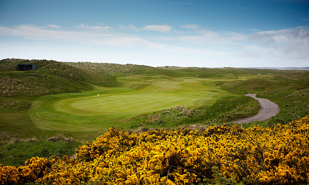 "Royal Aberdeen Golf Club 2nd (par 5, 507 yards)                     LOCAL KNOWLEDGE: ""Through the valley, the hole now plays out to a long, thin green, protected high front right by a pot bunker and front left by a typical asymmetrical (James) Braid bunker built into the green's side contours."" - Ronnie McCaskill, PGA Director of Golf"
