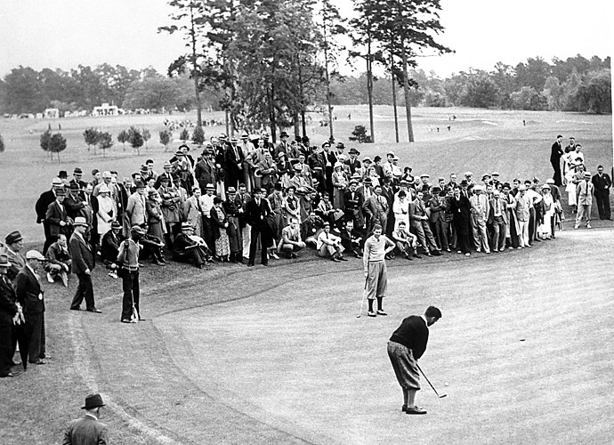 Horton Smith watches Bobby Jones putt at the inaugural Masters. Smith took the title, while Jones never won the tournament he helped create.