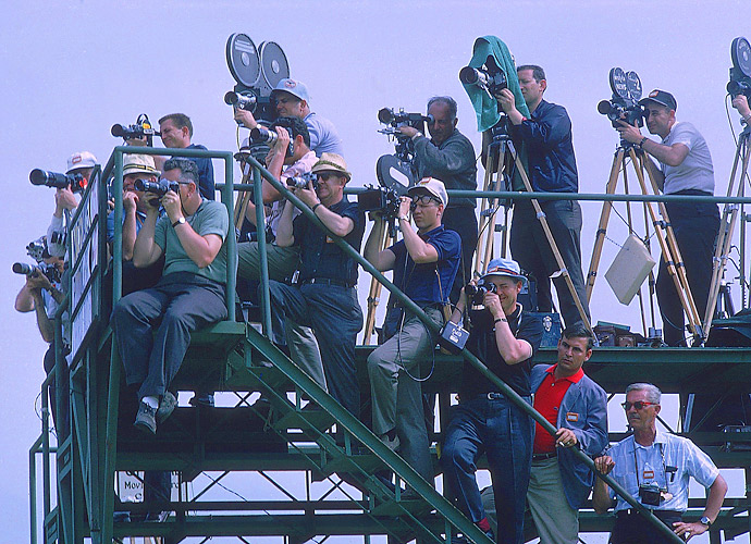 The Masters was the first event to erect viewing towers for the media [shown at work in 1965]. It would soon be broadcast both in color and live overseas.