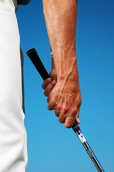 CHOKE DOWN                                              Set your hands near the bottom of the grip so that your right thumb is nearly touching the shaft. This makes your sand wedge or lob wedge much shorter and automatically reduces the amount of power you can deliver to the ball.