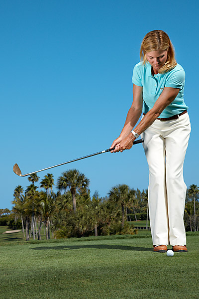 "MAKE A THUMP                                              Your choke grip and narrow stance make it easy to limit your backswing using your normal tempo. Now, swing forward with smooth acceleration and try to ""thump"" the ground under the ball with the sole of your wedge. The ball will come off the face softly and fly the short distance you need."