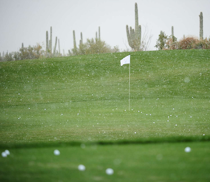 A sudden snow storm rolled over the course at Dove Mountain hours after play began, suspending the first round.