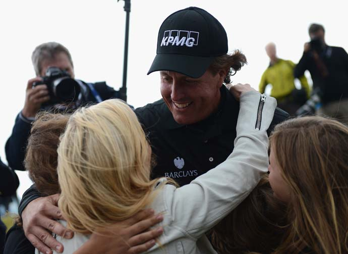 Phil Mickelson embraces his wife Amy on Sunday after his Scottish Open win.