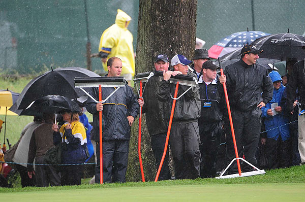 Play was suspended at 10:16 a.m. EST due to rain.