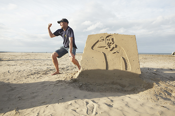 Doug Clement, founder of Kingsbarns Distillery, poses with a sand sculpture of Seve Ballesteros. The sand sculpture was one of many made by Peter Bignell on the beaches bordering the Old Course.