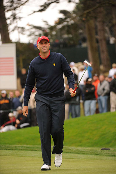 Stewart Cink set the tone, defeating Adam Scott for the first U.S. point of the day.