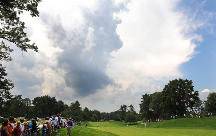 Players started to warm-up on the range, but another storm passed through and halted play for good.