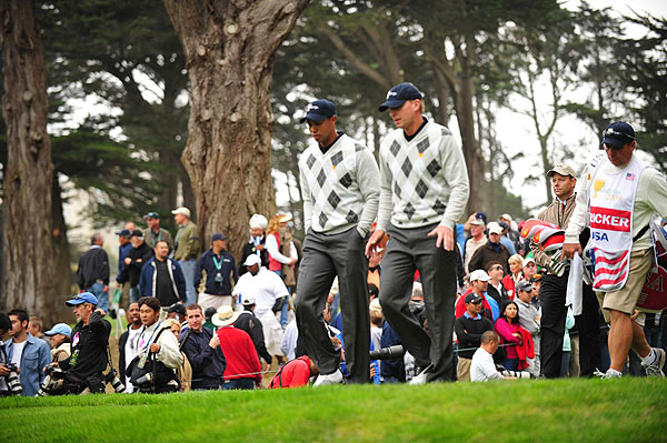 With an eagle on 18, Woods and Steve Stricker remained undefeated, winning their match over Mike Weir and Tim Clark.