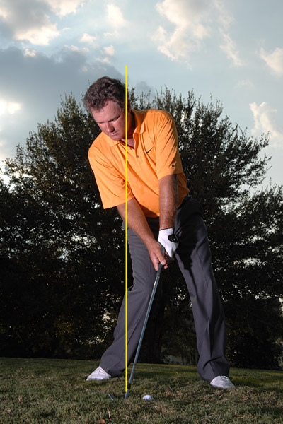 STEP 3                                              Feel like your left ear is behind the ball as you swing through impact, and keep your hands even with or slightly behind the clubhead when you make contact. Getting your hands ahead of the clubhead — like you're told to do on most iron shots — delofts the club and ruins your chances of flying the obstacle.
