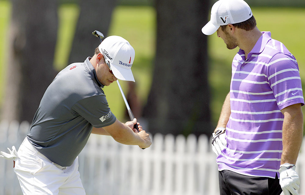 Zach Johnson, left, gave Tebow a lesson during the 2011 St. Jude Classic pro-am.