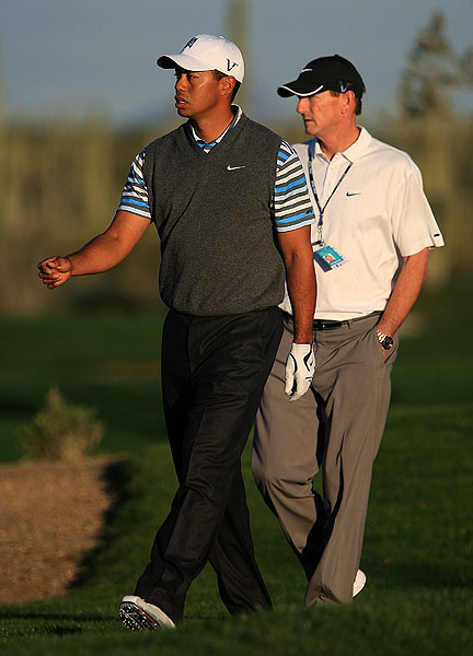 Swing coach Hank Haney joined him during the practice round.