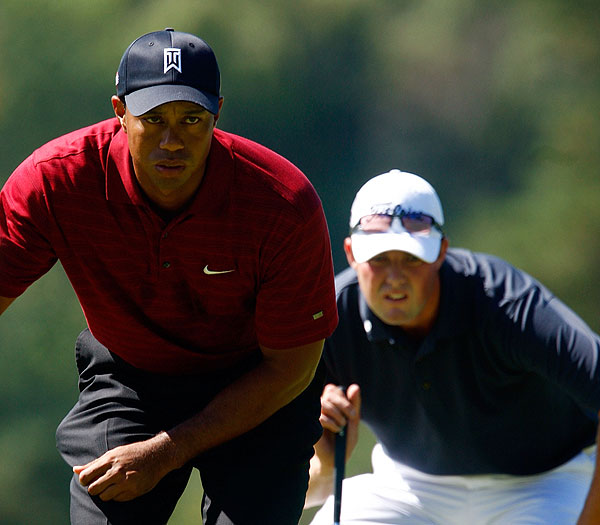held on to a tie for second place, playing with Tiger, with a bogey-free 69.