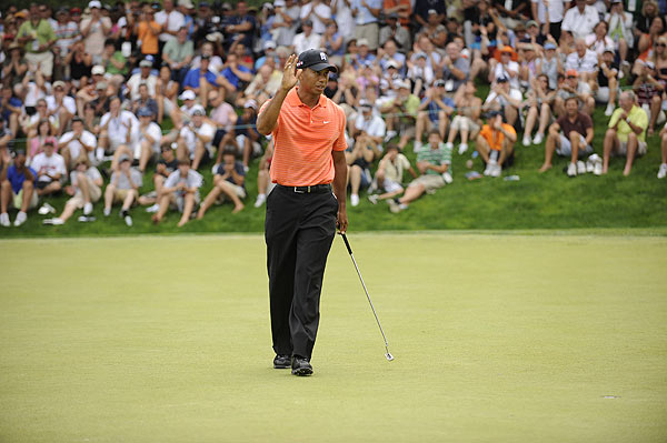 Tiger Woods got off to a hot start with four birdies on the front nine.