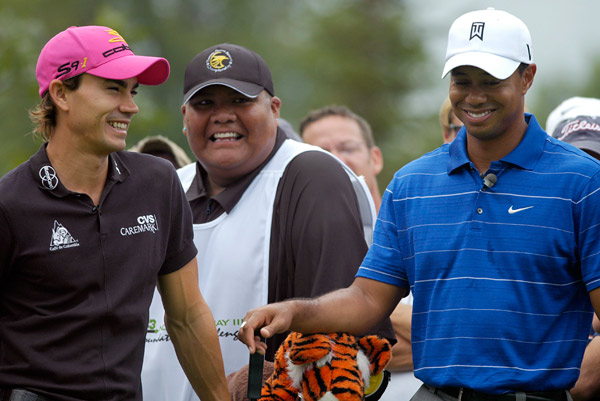 Woods and Camilo Villegas have some fun at the pressure-free charity event.