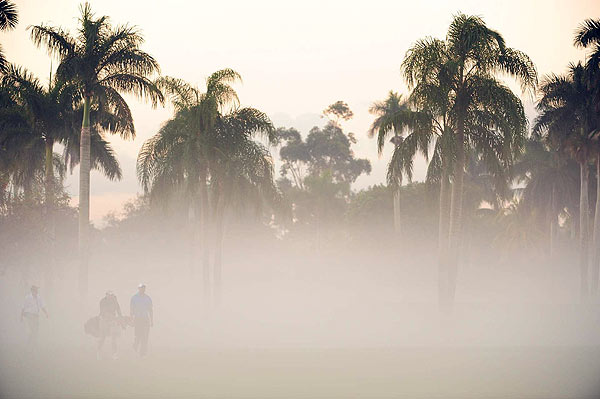 Tiger's WGC-CA Championship Practice Round                       The fog had barely lifted as Tiger Woods and his caddie Steve Williams made their way out to the course at Doral early Wednesday morning.