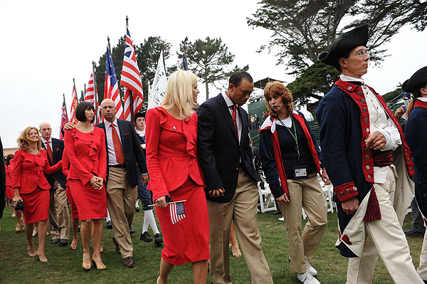 Players for the U.S. team were led out of the ceremony by their wives, including Tiger Woods with his wife, Elin, and Stewart Cink, with his wife, Lisa.