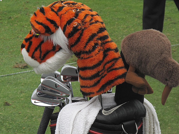 is well-known for his Tiger headcover, but he also protects his three-wood with a kiwi in honor of his caddie, New Zealander Steve Williams.