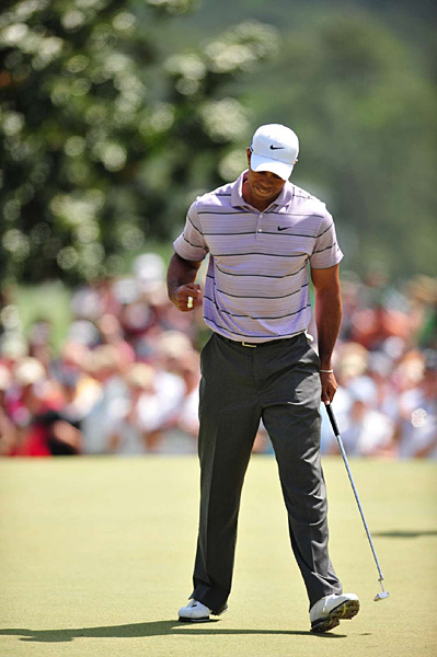 Woods started well, with birdies on Nos. 1 and 3.