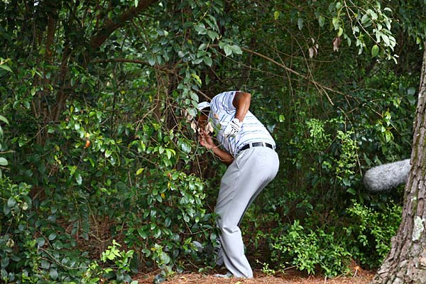 Woods put his drive in the trees on the par-5 second hole. He chipped out from his knees and managed to save par.