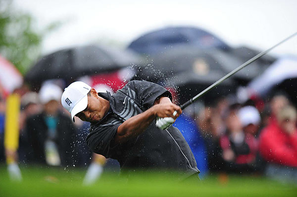"First Round of the U.S. Open                       Tiger Woods began his first round of the U.S. Open in the rain, and he sent his opening drive far left.                                                                                                                                            function fbs_click() {u=""http://www.golf.com/golf/gallery/article/0,28242,1905392,00.html"";t=document.title;window.open('http://www.facebook.com/sharer.php?u='+encodeURIComponent(u)+'&t='+encodeURIComponent(t),'sharer','toolbar=0,status=0,width=626,height=436');return false;} html .fb_share_link { padding:2px 0 0 20px; height:16px; background:url(http://b.static.ak.fbcdn.net/images/share/facebook_share_icon.gif?8:26981) no-repeat top left; }Share on Facebook                                                                                                                                                                                        addthis_pub             = 'golf';                                               addthis_logo            = 'http://s9.addthis.com/custom/golf/golf_logo.jpg';                                              var addthis_offset_top = -155;                                              addthis_logo_color      = '555555';                                              addthis_brand           = 'Golf.com';                                              addthis_options         = 'email, facebook, twitter, digg, delicious, myspace, google, reddit, live, more'                                                                                                                                            Share"