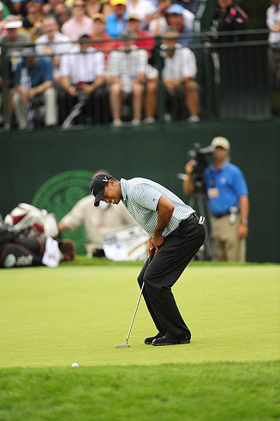 Woods missed some early birdie putts, and made the turn at two over par.