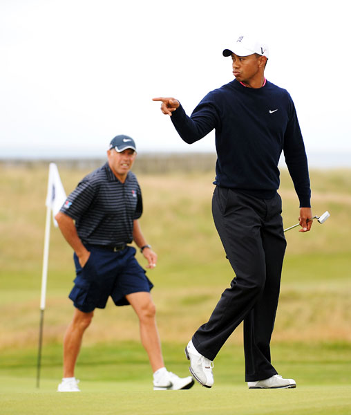 Tiger Woods with caddie Steve Williams on the 15th green.