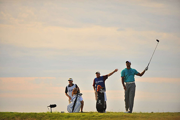 Woods and his caddie, Steve Williams, signaled an errant drive.
