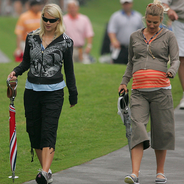 Elin Woods and Emma Stenson, right, followed their husbands, Tiger and Henrik, during the first round.                    • See the latest news and photos about Tiger Woods