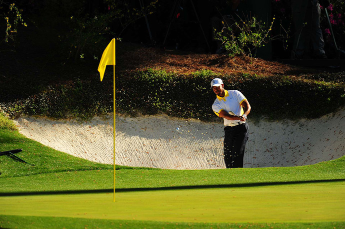 Woods got up-and-down at the par-3 12th.