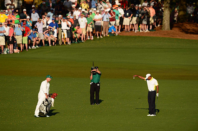 Woods took a drop and got up-and-down for bogey.