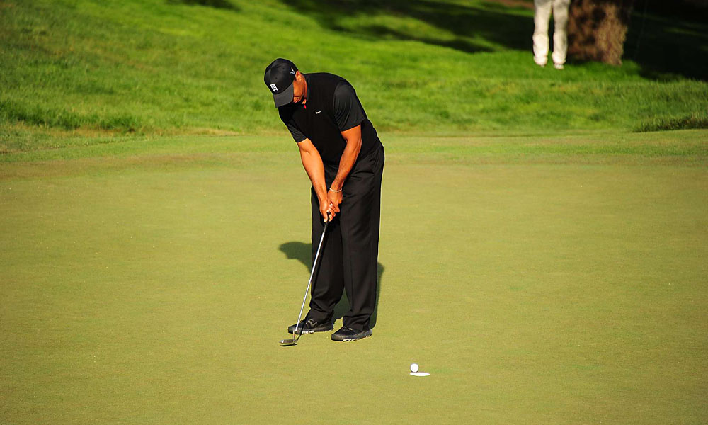 Woods got up-and-down from a bunker on 18 to work his way into Saturday's final pairing.