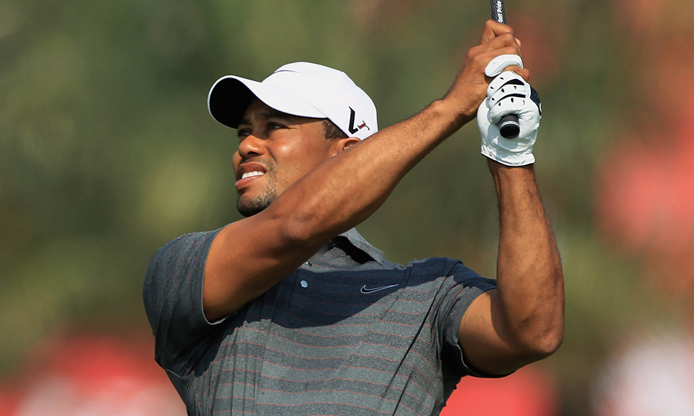 Tiger Woods charged into a tie for the lead at the Abu Dhabi Championship with a six-under 66 in the third round.